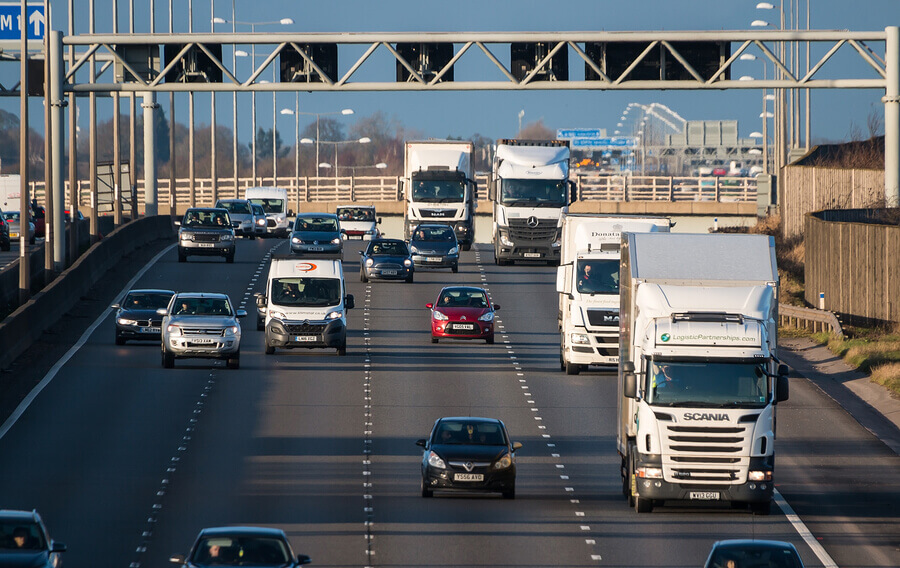 A motorway with cars and lorries driving on it
